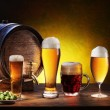 Stock Photo: Beer barrel with beer glasses on a wooden table.