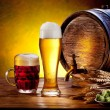 Beer barrel with beer glasses on a wooden table. — ストック写真