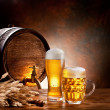 Beer barrel with beer glasses on a wooden table. — Stock Photo #10633432