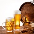 Beer barrel with beer glasses on a wooden table. — Stock Photo #10633487