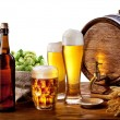 Beer barrel with beer glasses on a wooden table. — Stock Photo #10633597