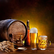 Beer barrel with beer glasses on a wooden table. — Stock Photo #10633637