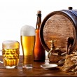 Beer barrel with beer glasses on a wooden table. — Стоковое фото