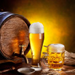 Beer barrel with beer glasses on a wooden table. - Stock Photo