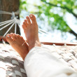 Feets in a hammock — Stock Photo