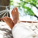 Feets in a hammock — Stock Photo