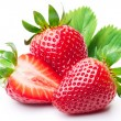 Strawberries with leaves. - Stock Photo