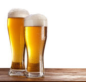 Two glasses of beers on a wooden table. — Stock Photo