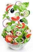 Uçan sebzeler - salata malzemeleri. — Stok fotoğraf