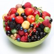 Stock Photo: Different berries in the bowl.