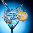 Stock Photo: Splash from pouring martini into glass.