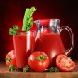 Tomatoes, jug and glass full of fresh tomatoes juice — Stock Photo