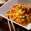 Chinese noodles with shrimps on a bamboo table - Stock Photo