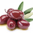 Purple olives in oil with leaves — Stock Photo #8983919