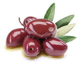 Purple olives in oil with leaves — Stock Photo