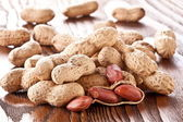 Peanuts on a wooden table. — Stock Photo