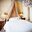 Luxury hotel bed — Stock Photo