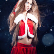 Beautiful young woman in Santa Claus clothes — 图库照片