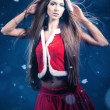 Beautiful young woman in Santa Claus clothes — ストック写真