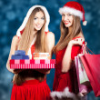 Sexy Snow Maiden with New Year's gifts — Stock Photo