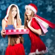 Sexy Snow Maiden with New Year's gifts — Stock Photo #8073024