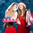 Sexy Snow Maiden with New Year's gifts — Stock Photo #8073029