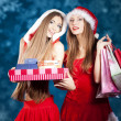 Stock Photo: Sexy Snow Maiden with New Year's gifts