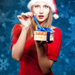 Beautiful young woman in Santa Claus clothes — Stok fotoğraf