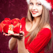 Beautiful young woman in Santa Claus clothes — Stock Photo #8073070