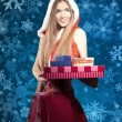 Beautiful young woman in Santa Claus clothes — Stock Photo #8073116