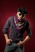 Cowboy in rotem hintergrund — Stockfoto