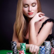 Sexy woman with game chips — Stockfoto