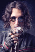 Rocker with a cigar — Stock Photo