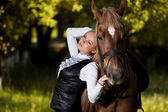 Walk of beautiful young girl with a horse — Stock Photo