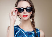 Beautiful and fashion girl in sunglasses — Foto de Stock