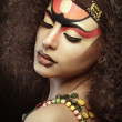 Stock Photo: Beautiful Africwomwith artistic make-up