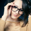 Beautiful and fashion girl in glasses, close-up portrait, studio shot — Stock fotografie