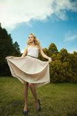 Beautiful blond girl in nature — Stock Photo