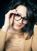 Beautiful and fashion girl in glasses, close-up portrait, studio shot — Stok fotoğraf