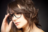 Beautiful and fashion girl in glasses, close-up portrait, studio shot — Стоковое фото