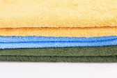 Towels on white background in studio — Stock Photo