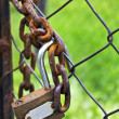 Stock Photo: Old padlock with rusting chain