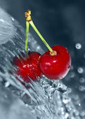 Blurry water being poured on cherries — Stock Photo
