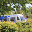 Light rail train seen through landscape - Stock Photo
