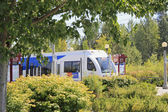 Light rail train seen through landscape — Stock Photo