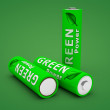Stock Photo: Three Green Eco Batteries on Green