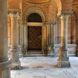 Stock Photo: Old door among columns