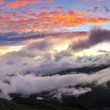 Sunset in the mountains after thunderstorm — Stock Photo