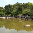 Stock Photo: Lake and stupas