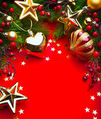 Art christmas frame with Christmas Decorations on red background — Stock Photo